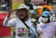 """A person shouts """"Where are our children?"""" during a march in remembrance of those who have disappeared, on Mother's Day in Mexico City, Monday, May 10, 2021. (AP Photo/Fernando Llano)"""