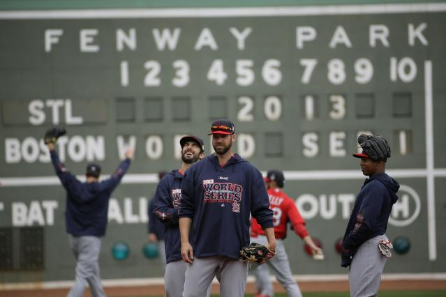 St. Louis Cardinals players warm up before batting practice for Game 1 of baseball's World Series against the Boston Red Sox Tuesday, Oct. 22, 2013, in Boston. (AP Photo/Matt Slocum)
