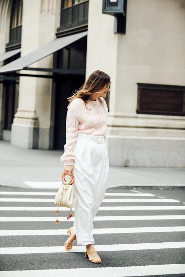 <p>Icy pastels are a fresh and on-trend alternative to creamy knits. With a pair of tailored white trousers, the look is as polished for the office as it is a holiday soirée. Take this outfit in a more festive direction with metallic heels and glittering jewels.</p>