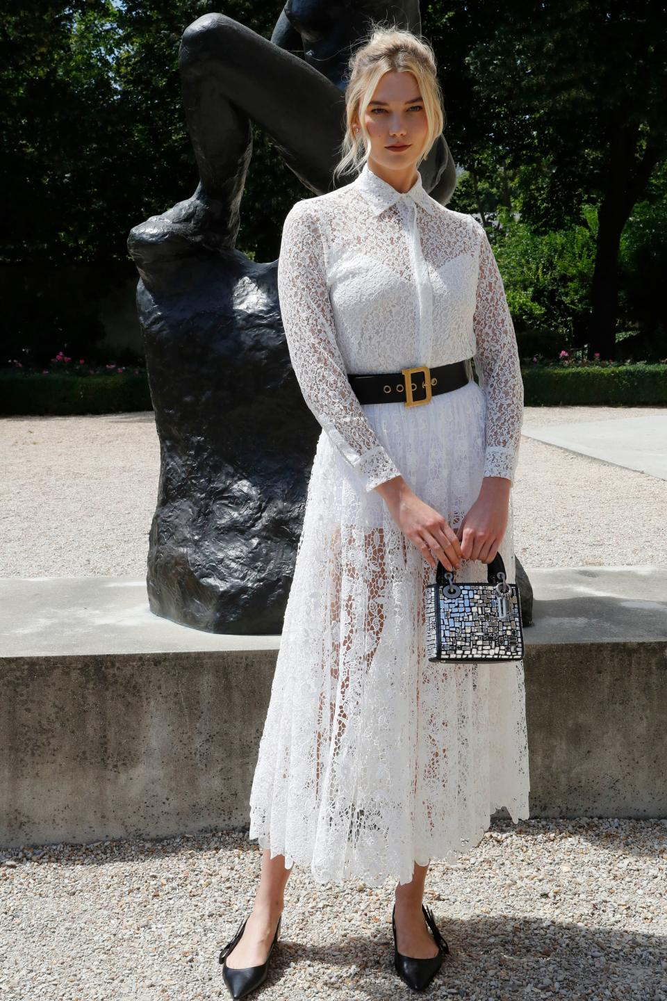 <p>Model Karlie Kloss chose a sheer lace dress and miniature handbag by Christian Dior for the label's haute couture show in Paris on 2 July. <em>[Photo: Getty]</em> </p>