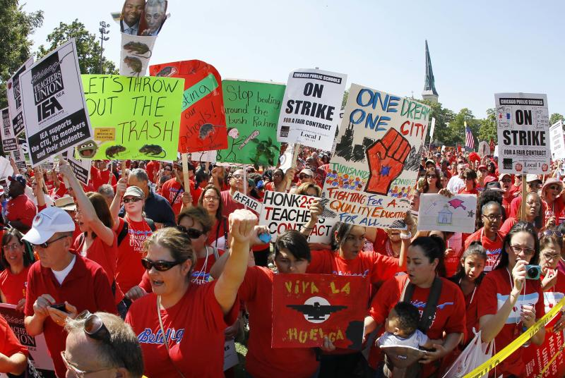 "Striking Chicago school teachers rally at Union Park Saturday, Sept. 15, 2012, in Chicago. Union president Karen Lewis reminded the crowd that although there is a ""framework"" for an end to their strike, they still are on strike.(AP Photo/Charles Rex Arbogast)"
