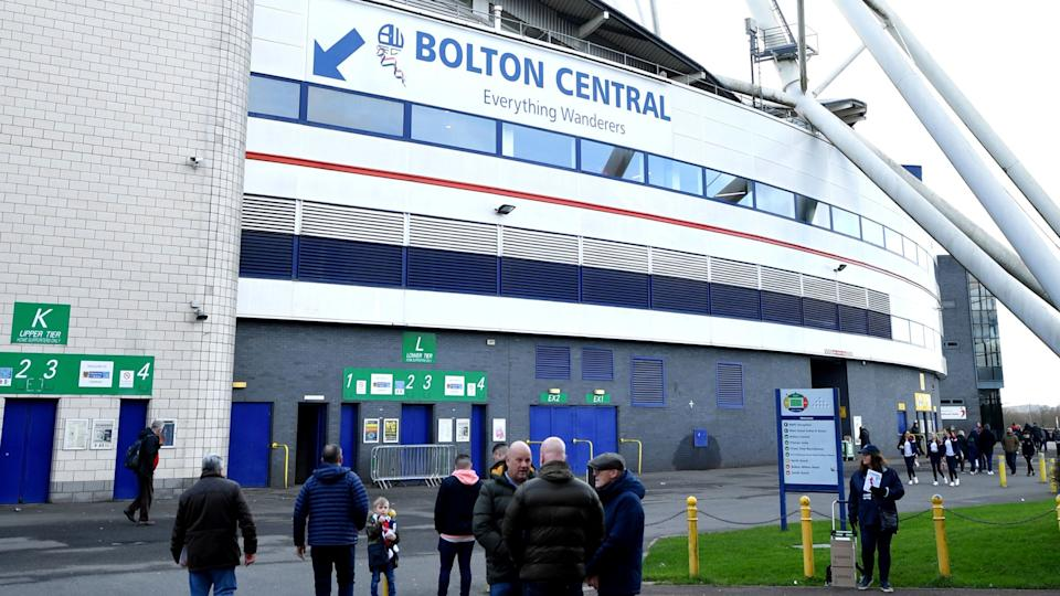 Fans stand outside the University of Bolton stadium