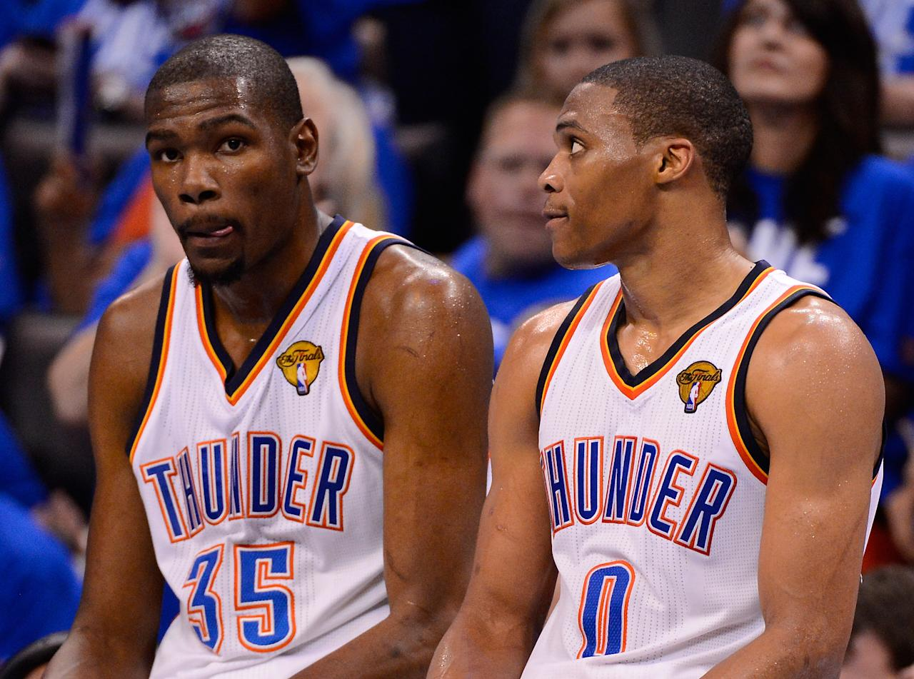 OKLAHOMA CITY, OK - JUNE 12:  Kevin Durant #35 and Russell Westbrook #0 of the Oklahoma City Thunder sits on the scorer's table in the fourth quarter while taking on the Miami Heat in Game One of the 2012 NBA Finals at Chesapeake Energy Arena on June 12, 2012 in Oklahoma City, Oklahoma. NOTE TO USER: User expressly acknowledges and agrees that, by downloading and or using this photograph, User is consenting to the terms and conditions of the Getty Images License Agreement.  (Photo by Ronald Martinez/Getty Images)