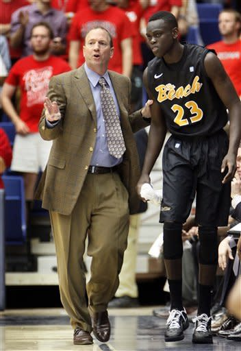 Long Beach State coach Dan Monson, left, talks Deng Deng (23) during the first half of an NCAA college basketball game against Arizona in Tucson, Ariz., Monday, Nov. 19, 2012. (AP Photo/Wily Low)