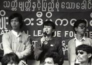 FILE PHOTO: Aung San Suu Kyi, main opposition leader in Myanmar addresses crowd of supporters in Rangoon