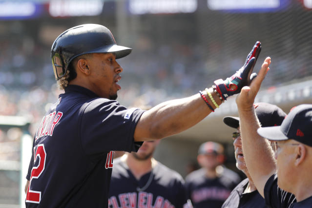Cleveland Indians' Francisco Lindor is greeted in the dugout after a solo home run during the third inning of a baseball game against the Detroit Tigers, Thursday, Aug. 29, 2019, in Detroit. (AP Photo/Carlos Osorio)