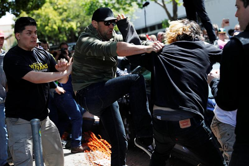 Demonstrators for and against U.S. President Donald Trump fight during rally in Berkeley, California: REUTERS
