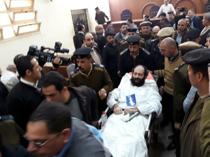 FILE PHOTO: Ramon Rasmi Mansour, known as Faltaous al-Makari, lies on a stretcher in a courtroom in Damanhour