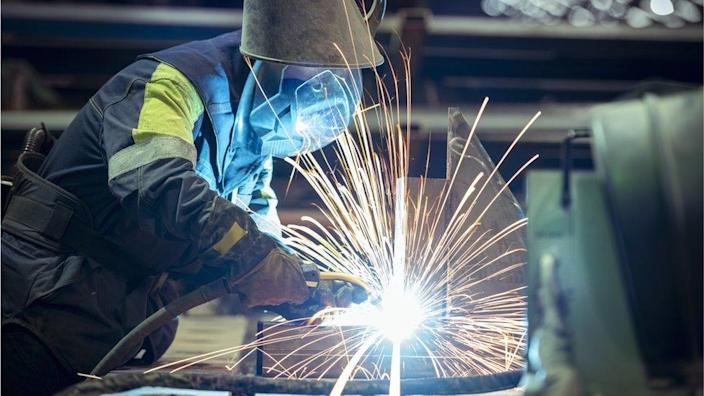 A welder at a steel plant
