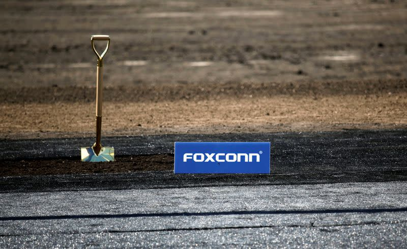 Shovel and FoxConn logo are seen before the arrival of U.S. President Donald Trump for the Foxconn Technology Group groundbreaking ceremony in Mount Pleasant