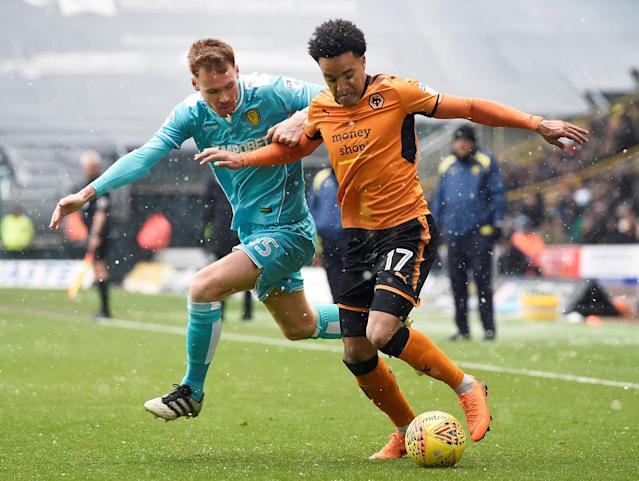 "Soccer Football - Championship - Wolverhampton Wanderers vs Burton Albion - Molineux Stadium, Wolverhampton, Britain - March 17, 2018 Wolves' Helder Costa in action with Burton's Tom Naylor Action Images/Alan Walter EDITORIAL USE ONLY. No use with unauthorized audio, video, data, fixture lists, club/league logos or ""live"" services. Online in-match use limited to 75 images, no video emulation. No use in betting, games or single club/league/player publications. Please contact your account representative for further details."