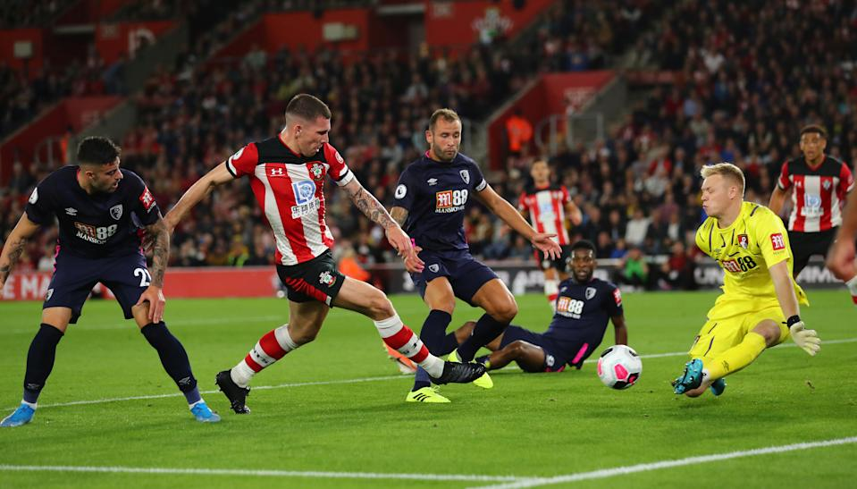 """Soccer Football - Premier League - Southampton v AFC Bournemouth - St Mary's Stadium, Southampton, Britain - September 20, 2019   Southampton's Pierre-Emile Hojbjerg in action with Bournemouth's Aaron Ramsdale    REUTERS/Eddie Keogh    EDITORIAL USE ONLY. No use with unauthorized audio, video, data, fixture lists, club/league logos or """"live"""" services. Online in-match use limited to 75 images, no video emulation. No use in betting, games or single club/league/player publications.  Please contact your account representative for further details."""
