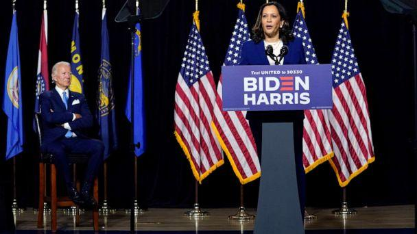 PHOTO: Democratic presidential candidate former Vice President Joe Biden listens as his running mate Sen. Kamala Harris speaks during a campaign event at Alexis Dupont High School in Wilmington, Del., Aug. 12, 2020. (Carolyn Kaster/AP)