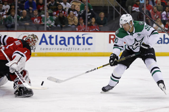 Dallas Stars center Jason Spezza (90) has his shot stopped by New Jersey Devils goaltender Keith Kinkaid in the first period of an NHL hockey game Tuesday, Oct. 16, 2018, in Newark, NJ. (AP Photo/Adam Hunger)