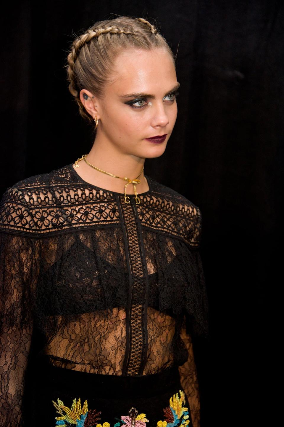<p>Delevingne made a case for neat dutch braids at the <strong>Suicide Squad</strong> Press Conference - worn with a middle part and a striking bordeaux-colored lipstick.</p>