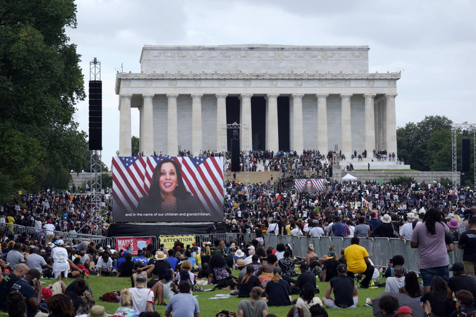 """FILE - In this Aug. 28, 2020, file photo, a screen displays a video with Democratic vice presidential candidate Kamala Harris speaking during the March on Washington at the Lincoln Memorial in Washington, on the 57th anniversary of the Rev. Martin Luther King Jr.'s """"I Have A Dream"""" speech. A tough road lies ahead for Biden who will need to chart a path forward to unite a bitterly divided nation and address America's fraught history of racism that manifested this year through the convergence of three national crises. (AP Photo/Carolyn Kaster, File)"""
