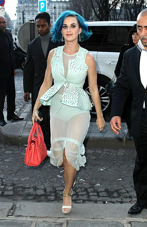 Pop tart Katy Perry left little to the imagination in a sheer ensemble while out and about in Paris on Thursday. While we adore her coral-colored Jimmy Choo handbag and strappy Christian Louboutin sandals, we abhor her tired blue tresses and minty Vera Wang mess of a dress. Oh, and those granny panties ... they belong under sweatpants, not on display during Fashion Week!