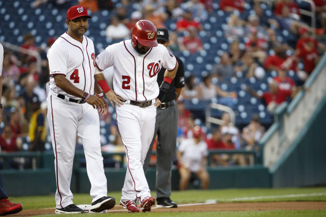 Washington Nationals manager Dave Martinez, left, walks with Adam Eaton as Eaton leaves the baseball game against the Baltimore Orioles during the first inning at Nationals Park on Wednesday, Aug. 28, 2019, in Washington. Eaton was hit by a pitch and struggled running to third on a later play. (AP Photo/Alex Brandon)