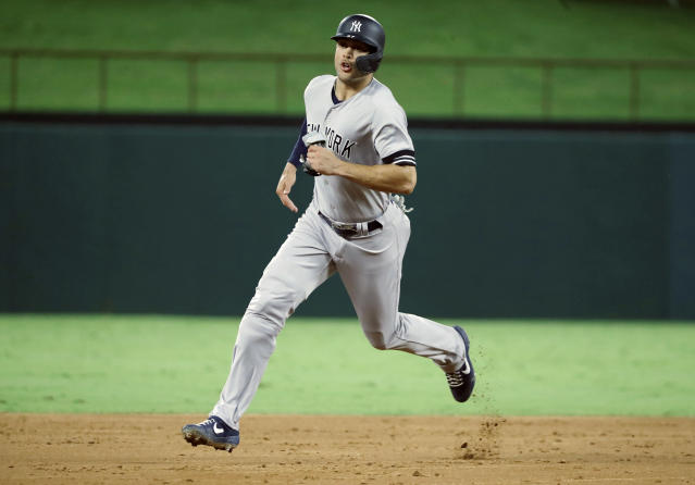 FILE - In this Sept. 27, 2019, file photo, New York Yankees' Giancarlo Stanton sprints to third during a baseball game against the Texas Rangers in Arlington, Texas. Yankees general manager Brian Cashman is optimistic Aaron Judge, James Paxton, Aaron Hicks and Giancarlo Stanton will be ready to play in time for New York's rescheduled opener at World Series champion Washington on July 23.(AP Photo/Tony Gutierrez, File)