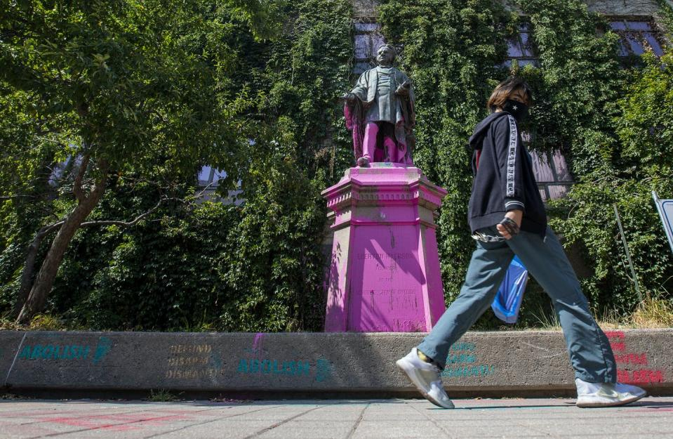 """<span class=""""caption"""">Black Lives Matter protesters threw pink paint on a statue of Egerton Ryerson at Ryerson University in Toronto on July 18, 2020. </span> <span class=""""attribution""""><span class=""""source"""">THE CANADIAN PRESS/Carlos Osorio</span></span>"""