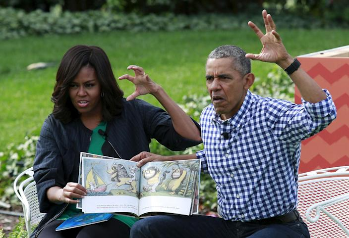 "<p>MAR. 28, 2016 — U.S. President Barack Obama and first lady Michelle Obama perform a reading of the children's book ""Where the Wild Things Are"" for children gathered for the annual White House Easter Egg Roll on the South Lawn of the White House in Washington. (Yuri Gripas/Reuters) </p>"