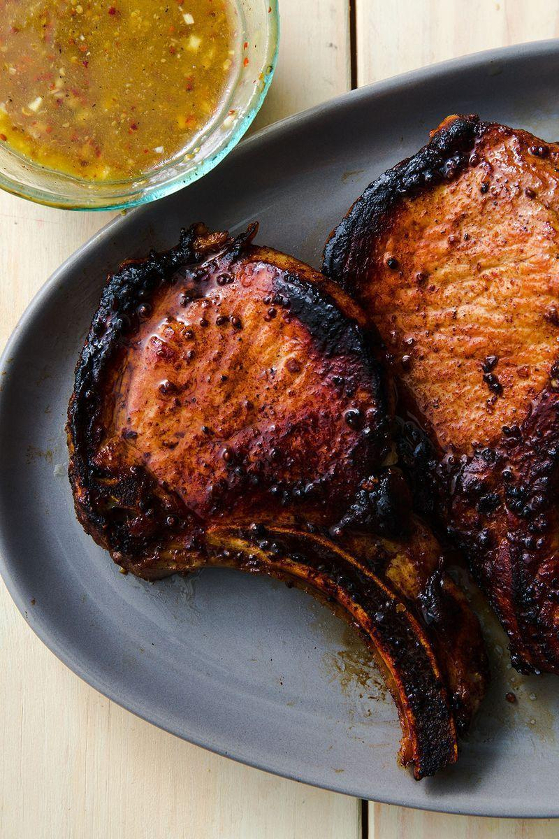 "<p>We chose to use this marinade on seared pork chops but it would go great on grilled or baked pork chops too. </p><p>Get the <a href=""https://www.delish.com/uk/cooking/recipes/a28826183/best-pork-chop-marinade-recipe/"" rel=""nofollow noopener"" target=""_blank"" data-ylk=""slk:Pork Chop Marinade"" class=""link rapid-noclick-resp"">Pork Chop Marinade</a> recipe.</p>"