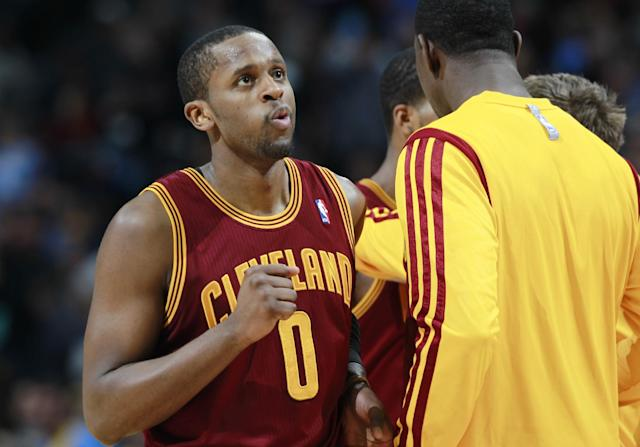 Cleveland Cavaliers guard C.J. Miles reacts as he heads to a timeout with only seconds remaining in the fourth quarter in an NBA basketball game against the Denver Nuggets in Denver, Friday, Jan. 17, 2014. The Cavaliers won 117-109. (AP Photo/David Zalubowski)