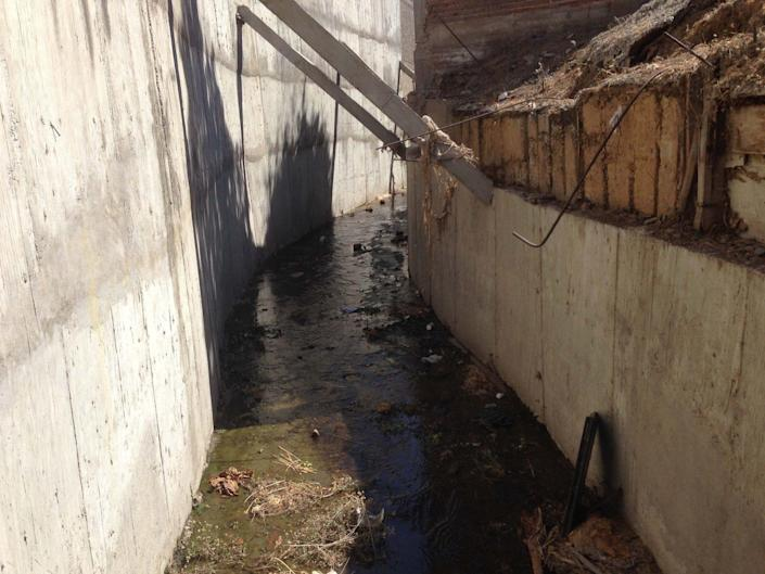 """Drug lord Joaquin """"El Chapo"""" Guzman escaped his captors by walking along this drainage canal and tunnel behind a house in Culiacan, Mexico, in February 2014."""