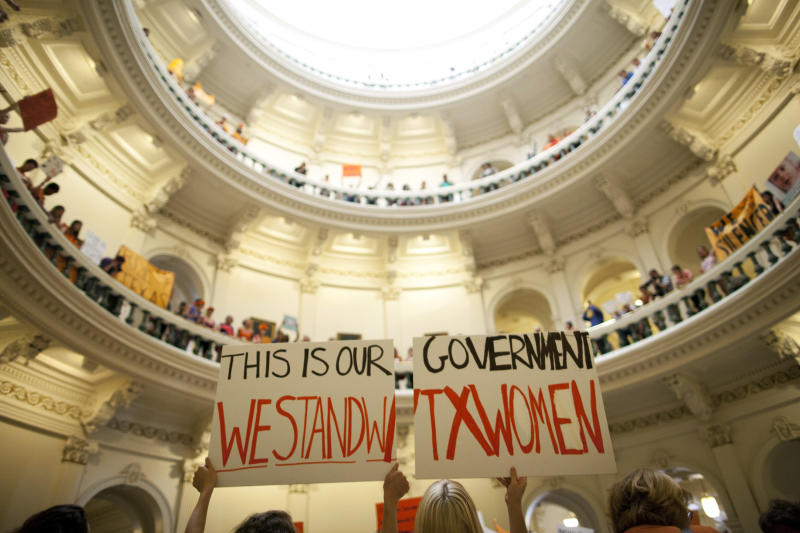 FILE - In this July 12, 2013, file photo, abortion rights supporters rally on the floor of the State Capitol rotunda in Austin, Texas. A sharply divided Supreme Court on Tuesday, Nov. 19, 2013, allowed Texas to continue enforcing abortion restrictions that opponents say have led more than a third of the state's clinics to stop providing abortions. (AP Photo/Tamir Kalifa, File)