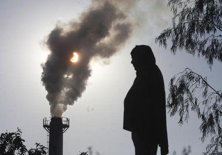 Smoke rises from a chimney of a garbage processing plant on the outskirts of Chandigarh