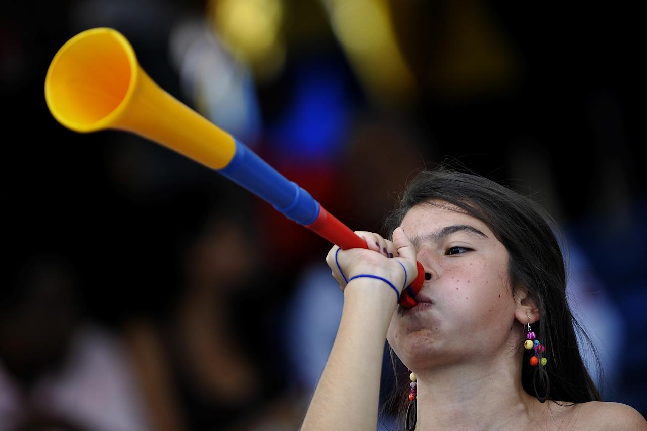 A fan of Colombia's football team blows a vuvuzela during a match between New Zealand and Cameroon in the U-20 World Cup Group B match at the Pascual Guerrero stadium in Cali on July 30, 2011.  AFP PHOTO / Luis ROBAYO (Photo credit should read LUIS ROBAYO/AFP/Getty Images)