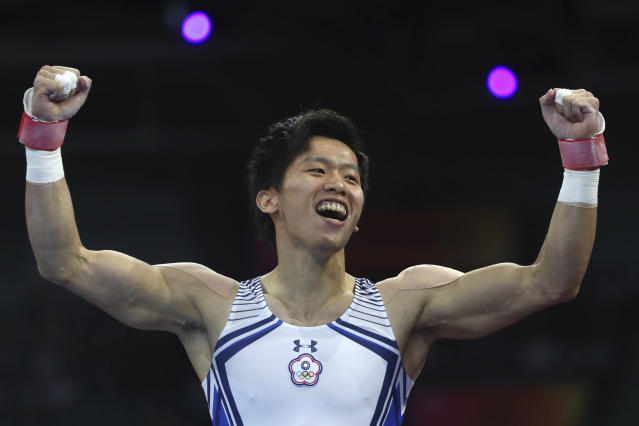 Silver medalist Lee Chih-kai of Taiwan celebrates after his performamce on the pommel horse in the men's apparatus finals at the Gymnastics World Championships in Stuttgart, Germany, Saturday, Oct. 12, 2019. (AP Photo/Matthias Schrader)