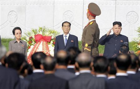North Korean leader Kim Jong-un salutes as a honour guard march past as he and his aunt Kim Kyong-hui, Premier Pak Pong-ju attend the opening ceremony of the Cemetery of Fallen Fighters of the KPA in Pyongyang