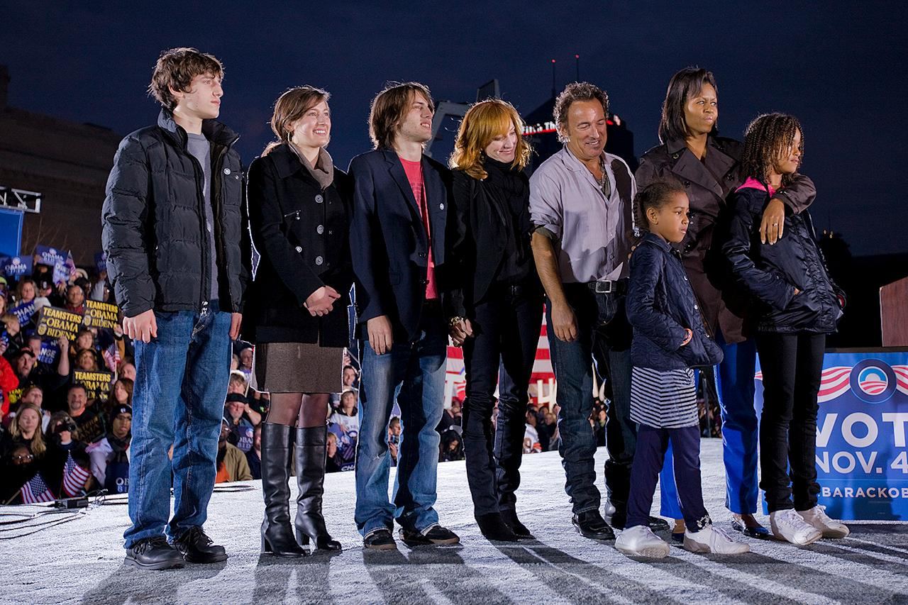 <p>Springsteen was also a prominent supporter of Barack Obama during his first presidential campaign in 2008. Here, the singer and his family are joined by Michelle Obama and her daughters, Malia and Sasha, while Obama speaks after Bruce's performance. </p>