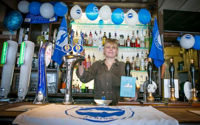<span>Stella Pollard, landlady of the Railway Bell, will maintain her 'home fans only' policy next season</span> <span>Credit: David McHugh for The Telegraph </span>