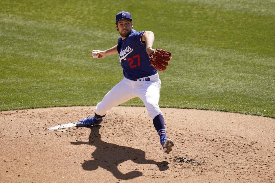 Pitching with one eye closed, Los Angeles Dodgers starting pitcher Trevor Bauer throws a pitch against the San Diego Padres during the second inning of a spring training baseball game Saturday, March 6, 2021, in Phoenix. (AP Photo/Ross D. Franklin)