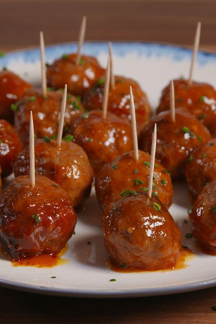 """<p>Don't let their size fool you, these slow-cooker mini meatballs are packed with flavor.</p><p>Get the recipe from <a href=""""https://www.delish.com/cooking/recipe-ideas/recipes/a50599/slow-cooker-party-meatballs-recipe/"""" rel=""""nofollow noopener"""" target=""""_blank"""" data-ylk=""""slk:Delish"""" class=""""link rapid-noclick-resp"""">Delish</a>.</p><p><em><strong>BUY NOW: Cocktail Toothpicks, $8; </strong></em><em><strong><a href=""""https://www.amazon.com/Royal-Bamboo-Cocktail-Doeuvre-Package/dp/B01D1XK4RQ/ref=sr_1_8?s=home-garden&ie=UTF8&qid=1498497273&sr=1-8&keywords=toothpicks+appetizer&tag=syn-yahoo-20&ascsubtag=%5Bartid%7C1782.g.2168%5Bsrc%7Cyahoo-us"""" rel=""""nofollow noopener"""" target=""""_blank"""" data-ylk=""""slk:amazon.com"""" class=""""link rapid-noclick-resp"""">amazon.com</a>.</strong></em></p>"""