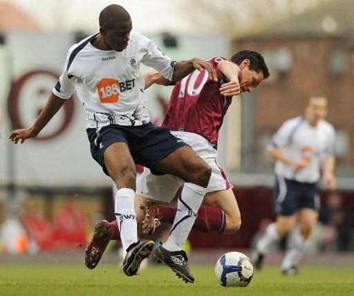 Fabrice Muamba (left) takes on West Ham's Guillermo Franco (R) during a Premier League match at Upton Park in in 2010. Democratic Republic of Congo-born Muamba's recovery from his collapse in March was hailed as miraculous but there were always questions as to whether he could play again