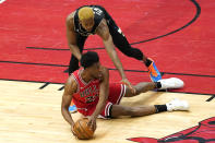 Chicago Bulls forward Thaddeus Young, bottom, looks to pass as Milwaukee Bucks forward Mamadi Diakite guards during the first half of an NBA basketball game in Chicago, Sunday, May 16, 2021. (AP Photo/Nam Y. Huh)