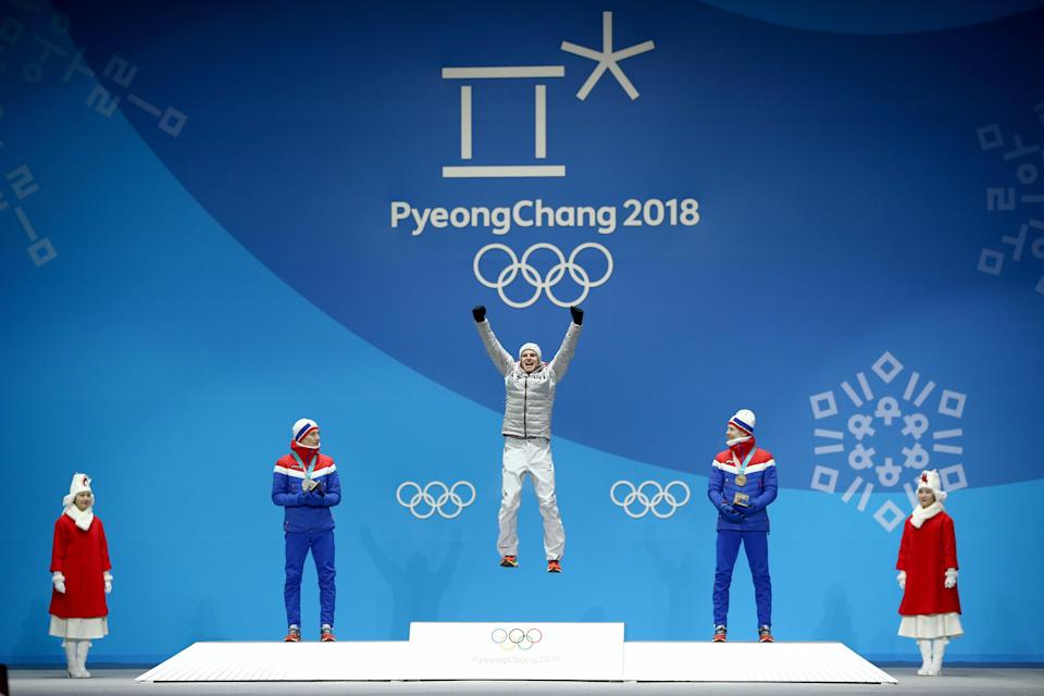 <p>Gold medalist Andreas Wellinger of Germany (C) celebrates on the podium with silver medalist Johann Andre Forfang of Norway (L) and bronze medalist Robert Johansson of Norway (R) during the Medal Ceremony for the Men's Ski Jumping Normal Hill Individual on day two of the PyeongChang 2018 Winter Olympic Games at Medal Plaza on February 11, 2018 in Pyeongchang-gun, South Korea. (Photo by Dan Istitene/Getty Images) </p>