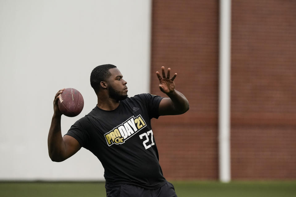FILE - In this March 16, 2021, file photo, Georgia Tech punter Pressley Harvin III, throws a pass during the school's Pro Day football workout for NFL scouts in Atlanta. NFL scouts who gathered for Georgia Tech's pro day didn't just want to see 263-pound punter Pressley Harvin boot the ball a mile. They also asked him to throw some passes, and he dazzled them with his arm, too. (AP Photo/Brynn Anderson, File)