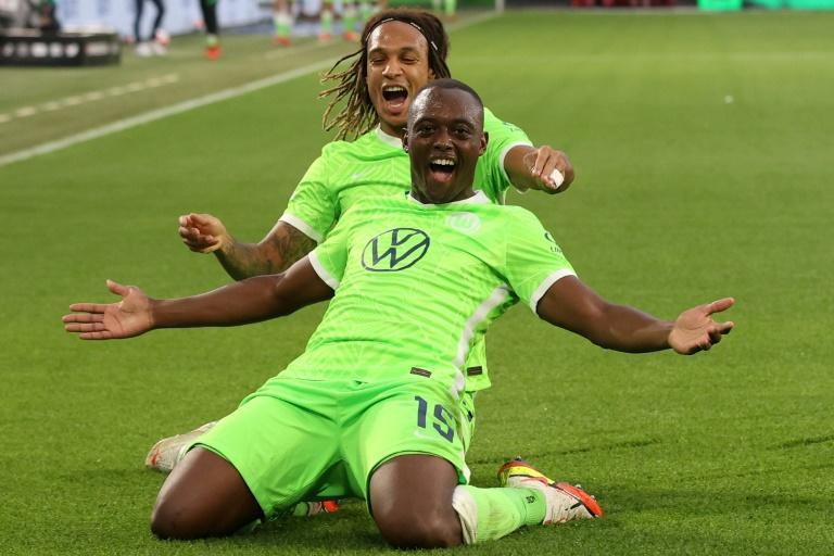 Wolfsburg's French defender Jerome Roussillon (front) celebrates his goal against Leipzig on Sunday (AFP/Ronny HARTMANN)