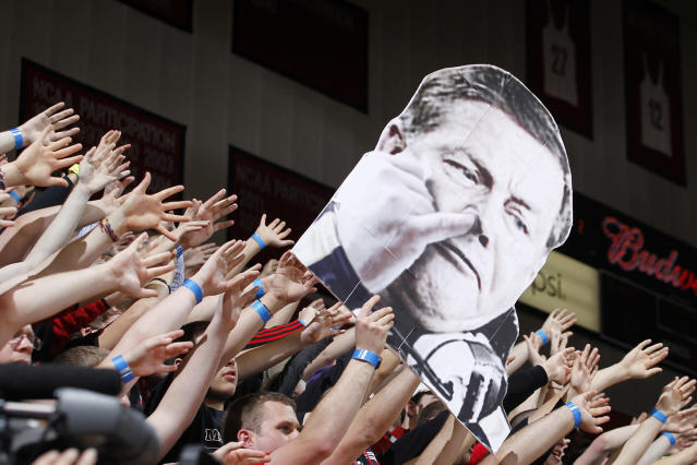 Cincinnati Bearcats fans hold up a cardboard cutout of Notre Dame Fighting Irish football coach Brian Kelly while trying to distract a free throw during the game at Fifth Third Arena on January 7, 2013 in Cincinnati, Ohio. Notre Dame defeated Cincinnati 66-60. (Photo by Joe Robbins/Getty Images)