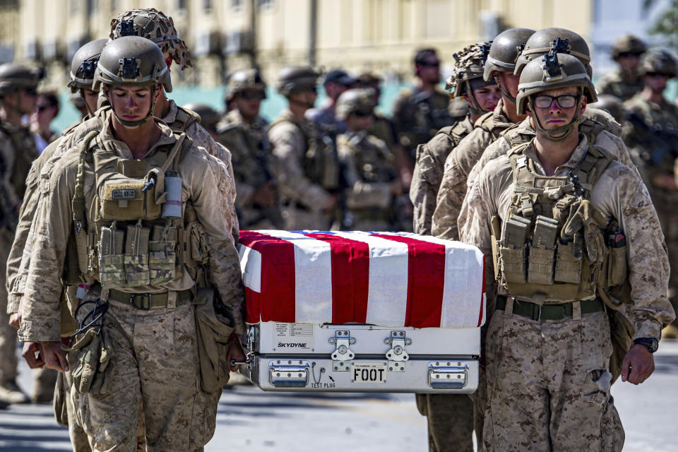 In this image provided by the U.S. Marine Corps, U.S. service members assigned to Joint Task Force-Crisis Response, are pallbearers on Friday, Aug. 27, 2021, for the service members killed in action during operations at Hamid Karzai International Airport in Kabul, Afghanistan, as transfer cases carrying the remains are placed aboard a U.S. Air Force plane for return to the United States. (1st Lt. Mark Andries/U.S. Marine Corps via AP)