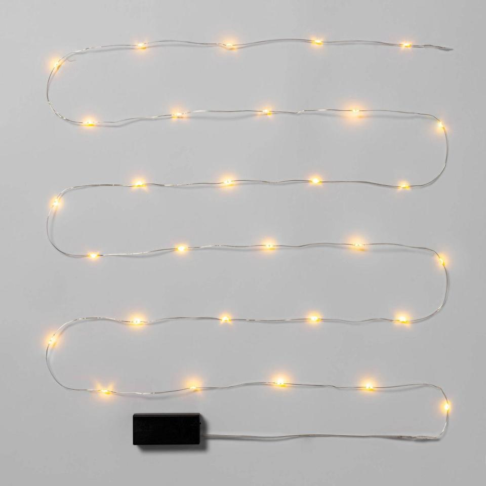 """<p>If you're looking to make a festive statement in a smaller space, Moore recommends decorating with a string of battery-powered fairy lights. """"The automatic timer makes them energy-efficient and easy to use,"""" she explains. </p> <p> <strong><em>Shop Now: </em></strong><em>Wondershop Christmas Battery Operated LED String Fairy Lights in Warm White Silver Wire, $6, <a href=""""https://goto.target.com/c/249354/81938/2092?subId1=MSLOurFavoriteChristmasLightstoBuyRightNowaharperChrGal8022885202011I&u=https%3A%2F%2Fwww.target.com%2Fp%2F30ct-christmas-battery-operated-led-string-fairy-lights-warm-white-silver-wire-wondershop-8482%2F-%2FA-54551292"""" rel=""""nofollow noopener"""" target=""""_blank"""" data-ylk=""""slk:target.com"""" class=""""link rapid-noclick-resp"""">target.com</a></em><em>. </em></p>"""
