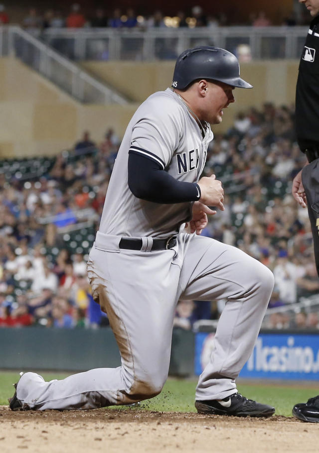 New York Yankees' Luke Voit celebrates as he scores the Yankees only run after Greg Bird broke up Minnesota Twins pitcher Jake Odorizz's no-hit bid with a double in the eighth inning of a baseball game Wednesday, Sept. 12, 2018, in Minneapolis. The Twins won 3-1. (AP Photo/Jim Mone)