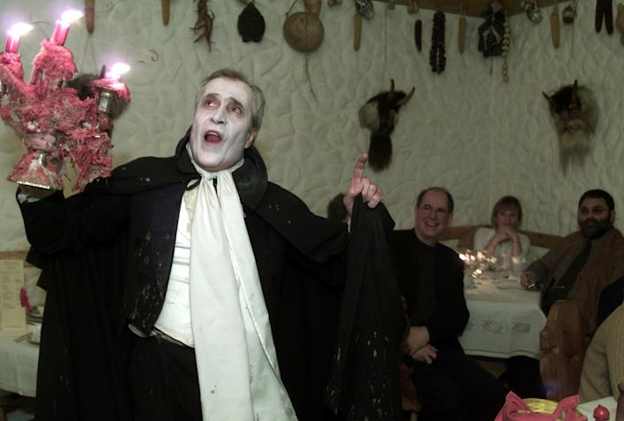 Romanian actor Petrica Moraru performs as the bloodthirsty Dracula for the guests at the Club Count Dracula restaurant in Bucharest March 2003. REUTERS/Bogdan Cristel