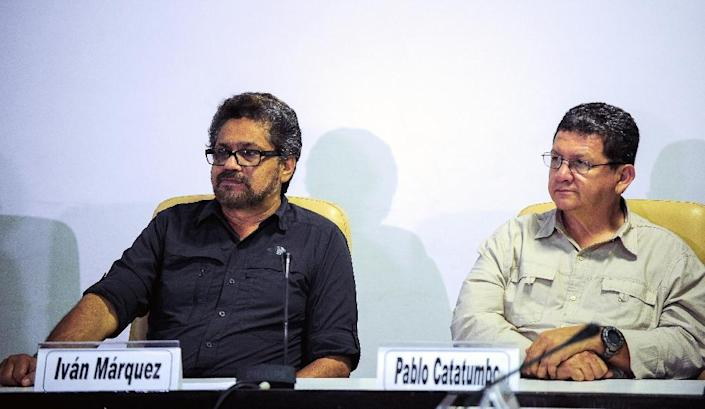 Commanders of the FARC-EP leftist guerrillas Ivan Marquez (L) and Pablo Catatumbo attend a press conference related to peace talks with the Colombian government at the Convention Palace in Havana, on March 7, 2015 (AFP Photo/Yamil Lage)