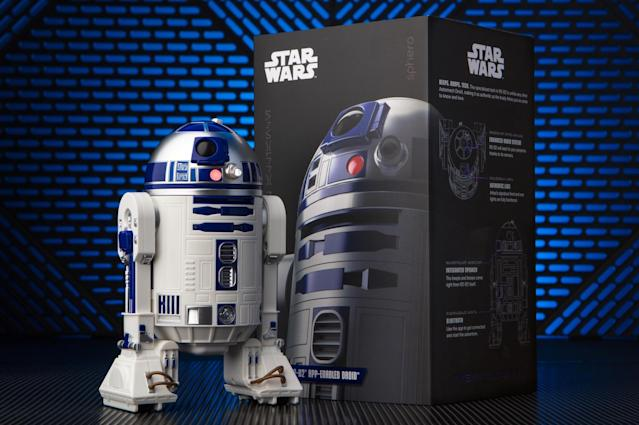 "<p>The robot-making whizzes at Sphero one-up <a href=""https://www.yahoo.com/entertainment/bb-8-remote-controlled-toy-star-wars-the-force-128264274727.html"" data-ylk=""slk:last year's phenomenal BB-8"" class=""link rapid-noclick-resp"">last year's phenomenal BB-8</a> with this interactive version of the OG astromech, R2-D2. Remote-controlled via smartphone and featuring Lucasfilm-sanctioned light and sound effects, Artoo is equipped to roam around your home, reveal holographic messages, react to <em>Star Wars</em> movies, and even communicate with fellow app-enabled droids BB-8 and the evil BB-9E. Like the box says, this is the droid you're looking for.<br><strong>Buy: <a href=""https://www.walmart.com/ip/Sphero-R2-D2-App-Enabled-Droid/56081736"" rel=""nofollow noopener"" target=""_blank"" data-ylk=""slk:Walmart"" class=""link rapid-noclick-resp"">Walmart</a></strong> </p>"