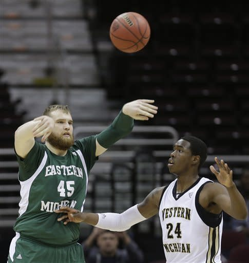 Eastern Michigan's Matt Balkema (45) passes in front of Western Michigan's Darius Paul (24) in the first half during an NCAA college basketball game at the Mid-American Conference men's tournament on Thursday, March 14, 2013, in Cleveland. (AP Photo/Tony Dejak)